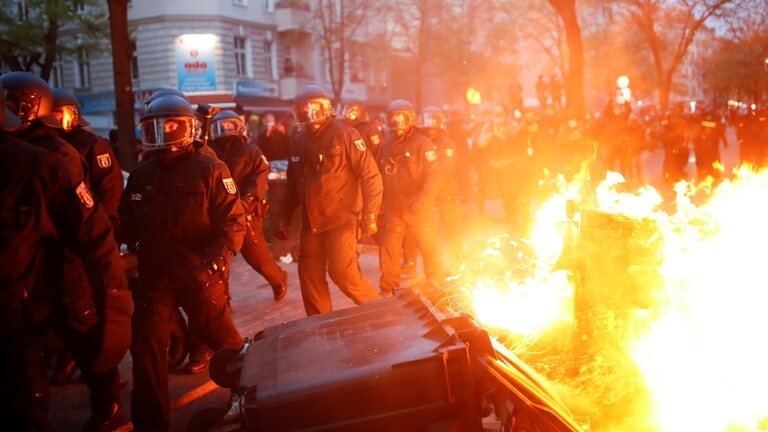 STREET SET ON FIRE AS POLICE AND MAY DAY PROTESTERS BATTLE IN BERLIN